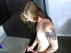 Taryn is a sexy Grooby girl with an amazing body, small hormone tits, a nice big hard cock and an amazing bubble butt! Taryn`s fooling around in the kitchen and gets horny, soon she`s naked and playing with her hard cock!