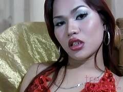 Thai shemale debutante Kimmy flaunts her young, tight body and her hard, eager cock.