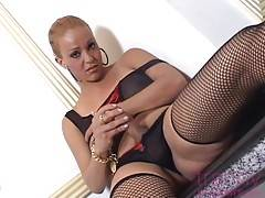 Curvy Latin shemale goddess Cinthia poses in her black lingerie, tempting you to cum and join her.